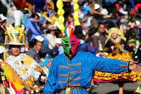 Kusillo figure taking part in parades at Gran Poder festival, La Paz, Bolivia