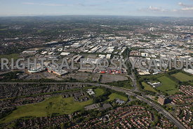 Manchester aerial photograph of Trafford Park looking from across the M 60 motorway and Junction 9 with the Trafford Centre and looking down the Parkway in towards the centre of the Industrial Estate and the distant horizon