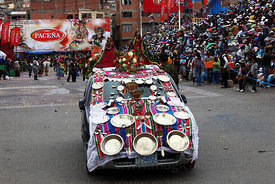 Decorated car with statues of Virgin Mary on roof, Oruro Carnival, Bolivia