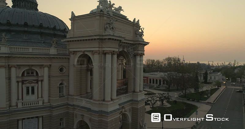 Aerial camera flies slowly towards the upper level of Odessa Opera Theatre at sunrise Ukraine