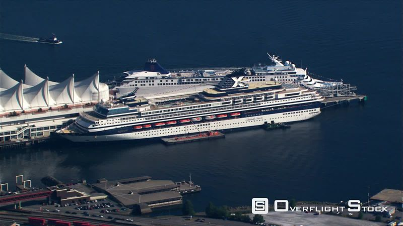 Zoom-out from cruise ships at Canada Pavilion to high aerial view of Vancouver, British Columbia.