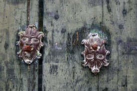 Detail of ornamental bronze faces on main door of St John the Baptist of Letrán / San Juan Bautista de Letrán church, Juli, Puno Region, Peru