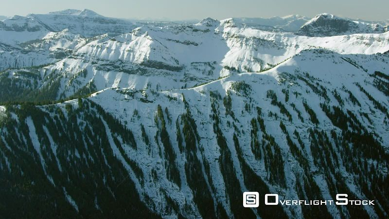 Avalanche chutes line a snowcovered mountain the Beartooth Moutnain Range near Yellowstone National Park