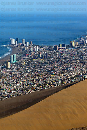 Aerial view of Cavancha Peninsula and huge sand dune