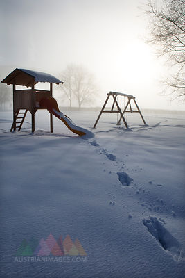 Austria, Mondsee, snow-covered playground