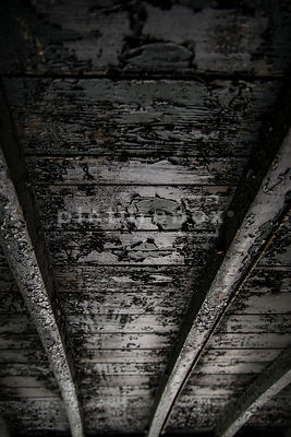 A background textured image of a burnt wooden train carriage roof.