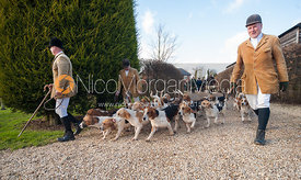 Semi-fisheye shots of the bassets leaving the meet