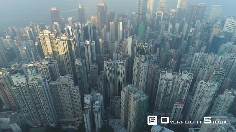 Hong Kong Residential Buildings. Aerial Vertical TopDown View. Drone is Flying Sideways Fast. Establishing Shot.