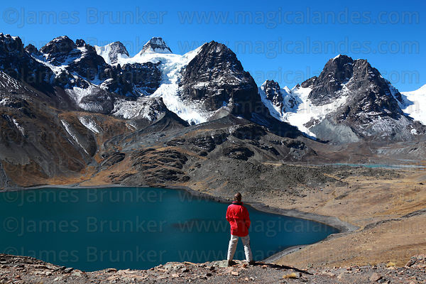 Hiker looking at view over Lake Chiar Kota to Mt Condoriri, Cordillera Real, Bolivia