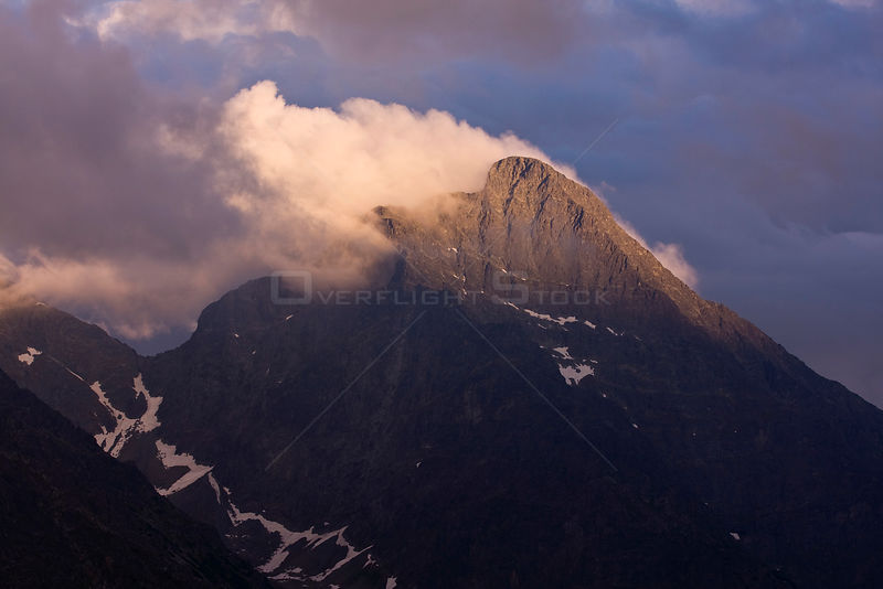 Mt. Krivan (national symbol of Slovakia). Western slope clearing after storm at sunset. Western Tatras, Slovakia, June 2008.