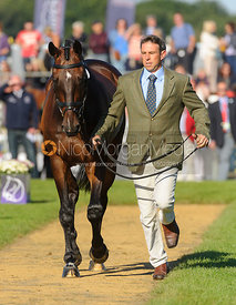 Sam Griffiths and HAPPY TIMES - The final vets inspection (trot up),  Land Rover Burghley Horse Trials, 8th September 2013.