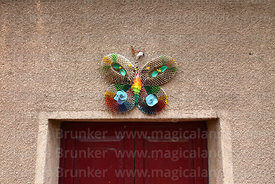 Paper butterfly above house doorway, Uyuni, Bolivia