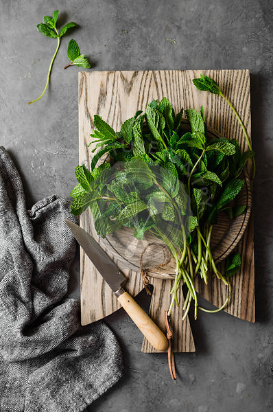Fresh mint leaves on a chopping board