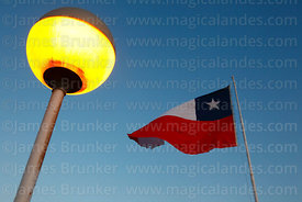 Chilean flag and street lamp on El Morro headland at twilight, Arica, Region XV, Chile