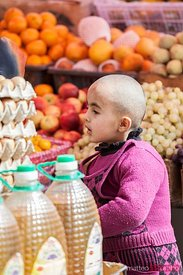 Young girl at the market of Tashkurgan, China