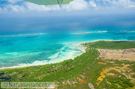 Aerial view of the Riviera Maya coastline in the Sian Ka'an Biosphere Reserve, south of Tulum, Yucatan Peninsula, Mexico.