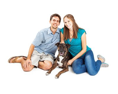 Young Couple With Mixed Breed Dog