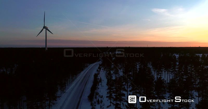 Wind Power Generators, 4k Aerial View Away from a Power Plant With a Renewable Energy Propeller, Cold Sunny Winter Evening Dawn, Hanko, Uusimaa, Finland