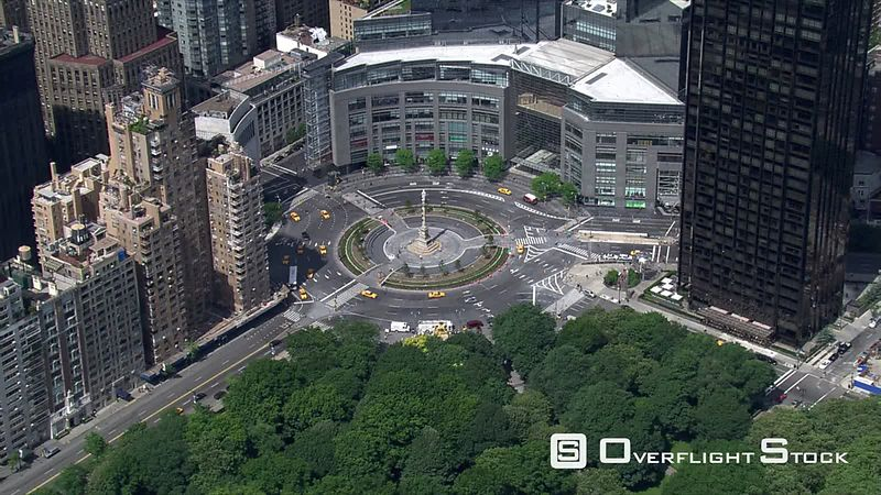 Flight circling New York's Columbus Circle with Time Warner Center in background.