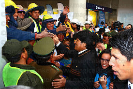 President Evo Morales (centre) greets Mi Teleferico company workers as he arrives for the opening ceremony of the Yellow Line cable car, El Alto, Bolivia