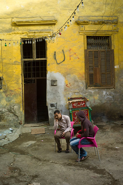 Egypt - Cairo - A man makes a call on his mobile telephone in an alleyway in the, Bein al-Qasreen area, Islamic Cairo