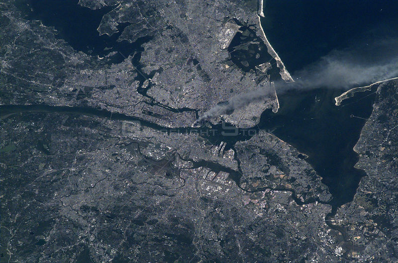 New York City -- September 11, 2001 -- Visible from space, a smoke plume rises from the Manhattan area after two planes crashed into the towers of the World Trade Center.