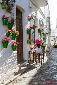 Woman sitting at outdoor cafe, Tarifa, Andalusia, Spain