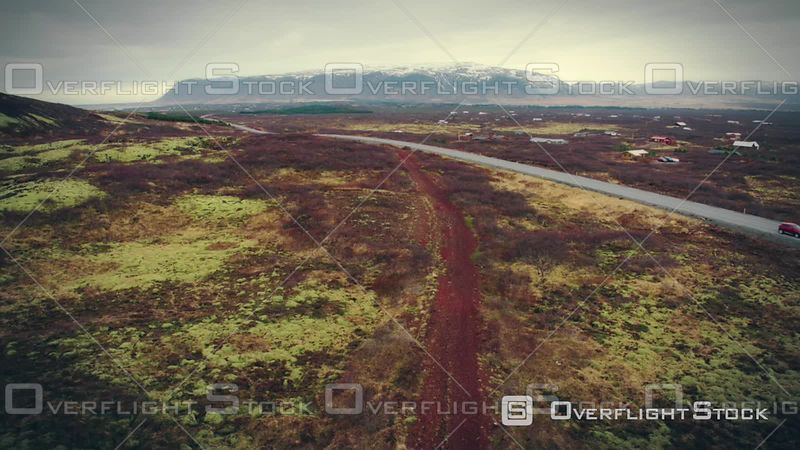 Aerial View of a Road Crossing Red Endless Icelandic Inland, Filmed by Drone, Nearby Kerid Crater, Selfoss, Iceland