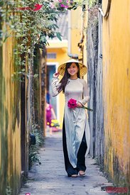 Vietnam, Hoi An. Young vietnamese girl walking in a alley