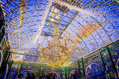 Christmas Market ornate Structure covered in Fairy Lights, Mistletoe and Hanging Chandelier
