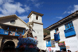 Figure of Virgen del Carmen outside church during main procession around village , Paucartambo , Peru