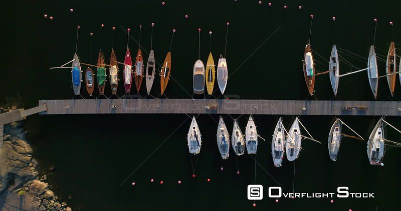 Boats at a harbour, aerial view above a harbor full of yachts and boat at liuskasaari island, on a sunny summer evening dusk, Helsinki, Uusimaa, Finland