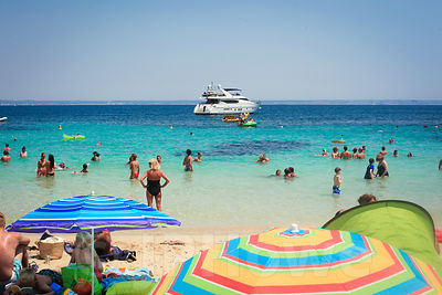 Holidaymakers enjoying a Sunny Mediterranean Beach