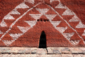 Detail of entrance and patterns of coloured chulpa in Rio Lauca valley, Bolivia