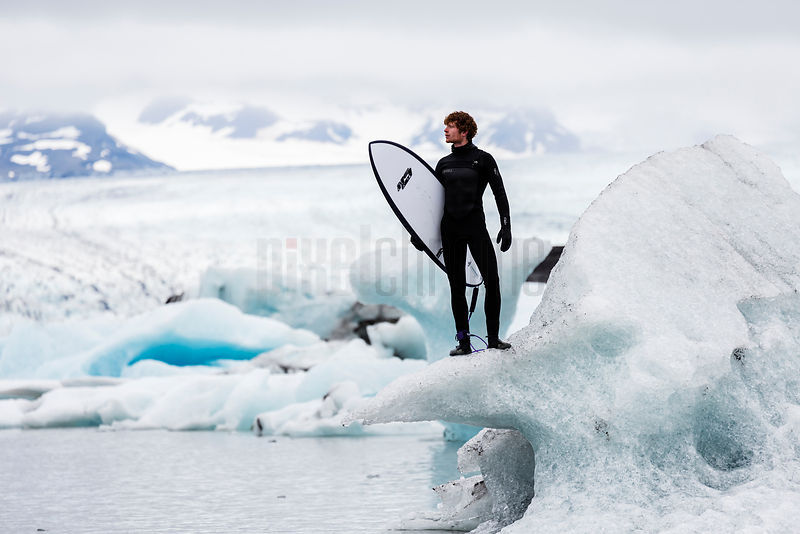 Surfer Standing on Calved Ice