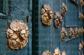 Detail of metal ornaments with angel faces on main entrance, Belén church, Cusco, Peru