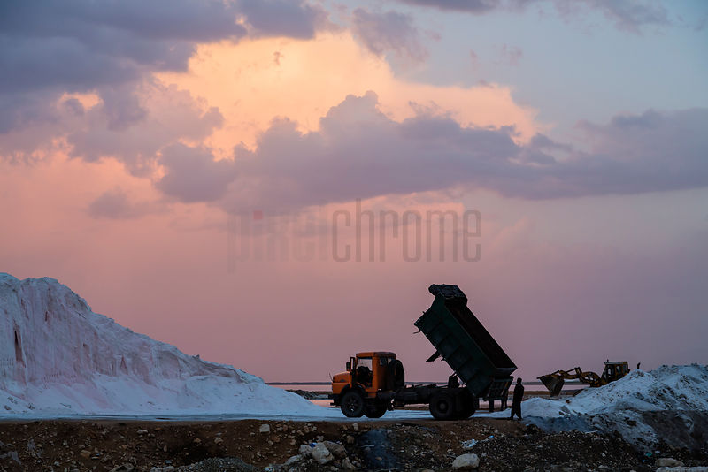 Salt Collection on the Shore of Maharlu Lake at Sunset