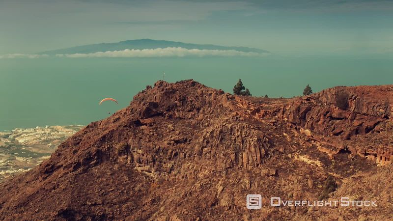 Paraglading in Tenerife near Los Gigantes, view on La Gomera, filmed by drone, Canary Islands