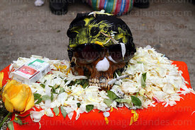 Skull wearing sunglasses and bandana smoking a cigarette, Ñatitas festival, La Paz, Bolivia