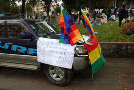 Car with message thanking president Evo Morales  at an event to celebrate Bolivia rejoining the 1961 UN Convention , La Paz , Bolivia