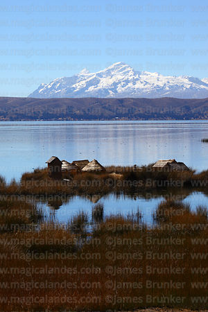 Reed houses near Quehuaya on Inner Lake, Mt Anochuma in background, Lake Titicaca, Bolivia