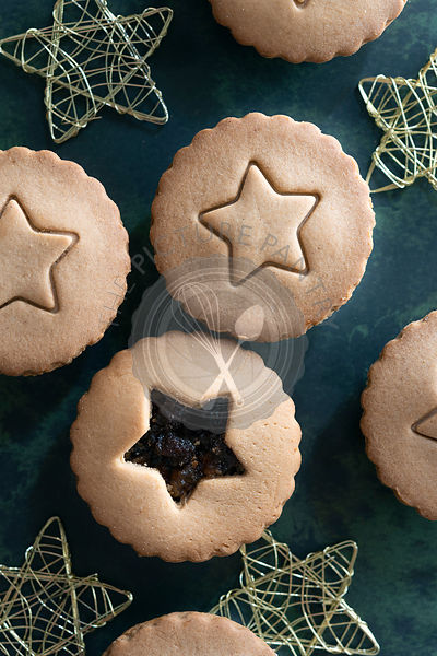 Traditional fruit mince pies with a star shape on the top.
