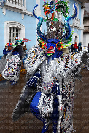 Masked male diablada devil dancer at Virgen de la Candelaria festival, Puno, Peru