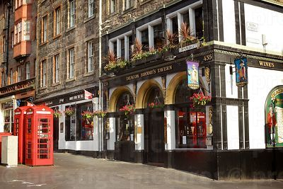 Edinburgh Pub with 2 red Telephone Boxes Outside