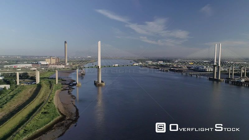 High level drone tracks sideways past QEII Bridge looking west on a sunny spring morning