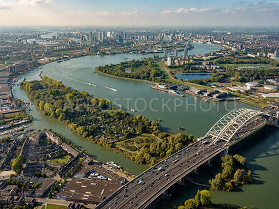 Rotterdam, Island of Brienenoord, the Brienoordbrug, the Nieuwe Maas and the skyline of Rotterdam.