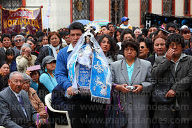 Devotees holding Virgen de la Candelaria statue during central mass, Puno, Peru
