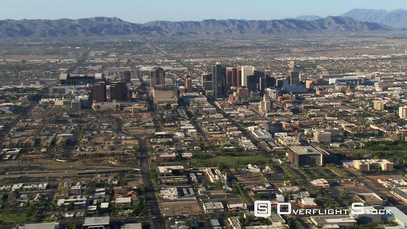 Wide orbit of Phoenix with downtown in mid-frame, mountains in background.
