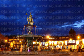 Statue of the Inca Pachacuti Inca Yupanqui or Pachacutec on fountain and Plaza de Armas at twilight, Cusco, Peru