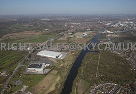 Liverpool Road, Peel Green, Eccles, high level view showing the infrastructure, M60 motorway, the Manchester Ship Canal and A J Bell Stadium and the  surrounding land under development by Peel Group